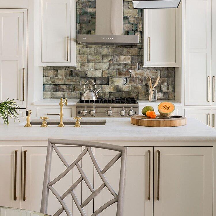 kitchen with natural stone backsplash tile